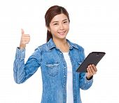 Woman with tablet and thumb up