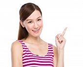 Asian woman with finger up