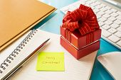 Red Gift Box And Sticky Note With Merry Christmas Message