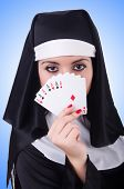 Nun playing cards on white