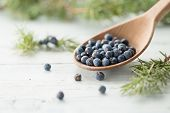 Wooden spoon with juniper berries