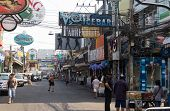 January 14, 2012: The street of Pattaya Walking street with advertizing signs in Thailand in the aft
