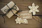 Joyeux Noël On A Banner With Christmas Decoration