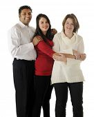 A biracial family portrait of three -- an Asian Indian dad, a caucasian mom and their teenage daughter.  On a white background.