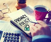 pic of policy  - Businessman Notepad Privacy Policy Concept - JPG