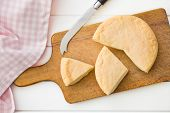the french cheese on cutting board