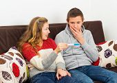 stock photo of teen pregnancy  - Irresponsible teenage couple facing serious problem pregnancy - JPG