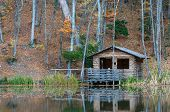 pic of backwoods  - old wooden house near the lake in forest