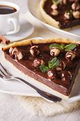 image of tarts  - Chocolate tart with hazelnut and coffee on the table close - JPG