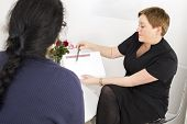 picture of body fat  - Female therapist consults patient or client - JPG
