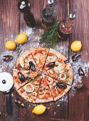 picture of hot fresh pizza  - hot fresh pizza with clams and lemon - JPG