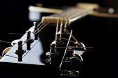 foto of fret  - Details of acoustic black guitar. neck nut frets strings. ** Note: Shallow depth of field - JPG