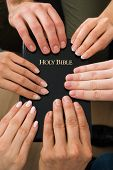 pic of holy-bible  - Group Of People Holding Holy Bible And Praying Together - JPG