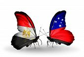 image of samoa  - Two butterflies with flags on wings as symbol of relations Egypt and Samoa - JPG