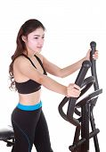picture of cardio exercise  - young woman doing exercises with exercise machine on white background - JPG