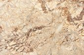 stock photo of fracture  - Closeup texture of fracture brown marble pattern - JPG