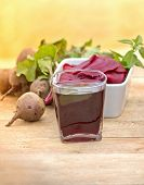 image of beet  - Healthy  beet juice and beat in a bowl on table  - JPG