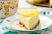 pic of cheesecake  - Slice of lemon cheesecake . selective focus ** Note: Shallow depth of field - JPG