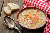 pic of pepper  - chicken soup with rice and peppers on a dark wood background - JPG