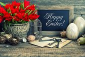 picture of nostalgic  - Vintage easter decoration with eggs and red tulip flowers - JPG