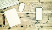 picture of workstation  - Office Workstation with Keyboard Phone Headphones Paper and Pen - JPG