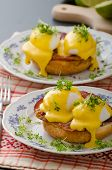 image of benediction  - Eggs benedict prosciutto topped with Hollandaise sauce - JPG