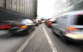 stock photo of merge  - Busy urban traffic with merging lanes in blurred motion - JPG
