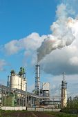 picture of chimney  - Air pollution by smoke coming out of two factory chimneys - JPG