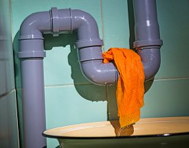picture of leak  - a water is leaking from a pipe - JPG