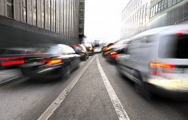pic of merge  - Busy urban traffic with merging lanes in blurred motion - JPG