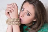 image of sadism  - girl with his hands tied - JPG