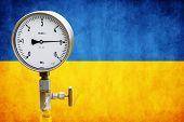 stock photo of air pressure gauge  - High pressure reading on gas wellhead isolated on flag Ukraine - JPG