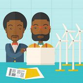 picture of generator  - Two black workers using laptop with windmills as power generator - JPG