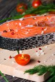 image of salmon steak  - Fresh raw salmon steak on wooden cutting board with salt - JPG