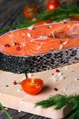 picture of salmon steak  - Fresh raw salmon steak on wooden cutting board with salt - JPG