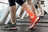 foto of ankle shoes  - Digital composite of Highlighted ankle of woman on treadmill - JPG