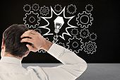 stock photo of scratching head  - Businessman scratching his head against black room - JPG
