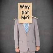 stock photo of anonymous  - Anonymous businessman against grey concrete tile - JPG
