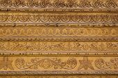 foto of woodcarving  - Close up ornamental wood carvings on the wall of monasteries in Bucovina - JPG