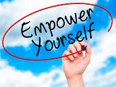 pic of empower  - Man Hand writing Empower Yourself with black marker on visual screen - JPG