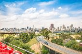 foto of building relief  - Wide angle view of Johannesburg skyline from the highways during a sightseeing tour around the urban area  - JPG
