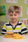 picture of greedy  - Greedy little child and fastfood for lunch - JPG