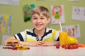 pic of kindness  - Smiling child and two kinds of snacks - JPG