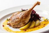 stock photo of roast duck  - Roast duck with beetroot - JPG