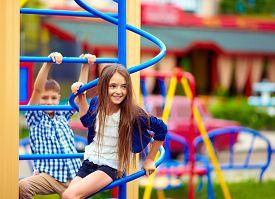picture of playground school  - cute teenage kids having fun on playground - JPG