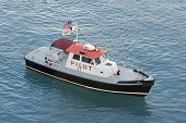 stock photo of u-boat  - U.S. Virgin Islands Pilot Boat cruising across the bay