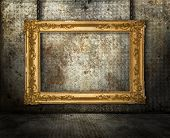 Grunge interior with gold frame