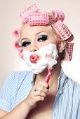 foto of shaving  - Attractive girl is having a shave - JPG