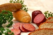 Salami, bread, rolls and parsley for a snack