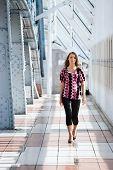 Walking girl. Modern bridge interior.